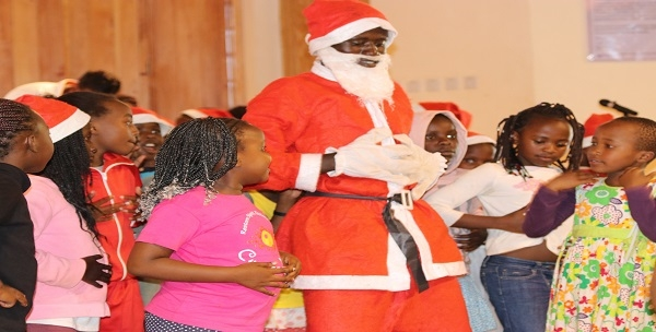Children performing a dance during the Christmas Maths and Science Fun day held at CEMASTEA