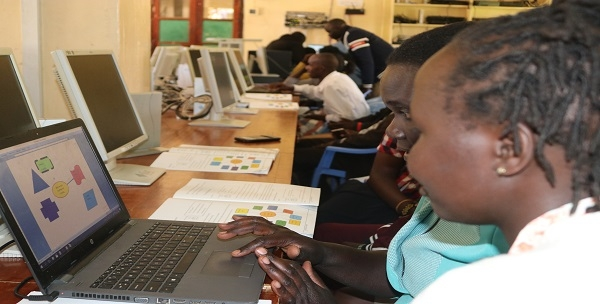 Participants developing lesson using ICT tools during ICT training